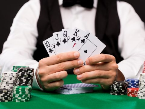 poker-player-with-cards-and-chips-at-casino